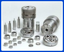 Various punch press tooling components made from tool steel