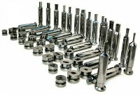 A selection of powder compaction tooling produced from tool steel